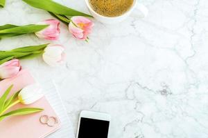 Flat lay of marble tabletop with flowers