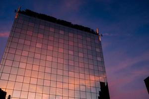 Building with reflection of colorful clouds photo