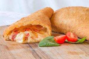 Close-up of tomato and mozzarella panzerotti