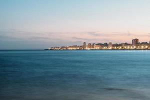 Illuminated coastal town