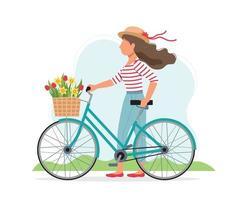 mujer con una bicicleta con flores en la canasta
