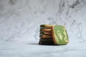 Sliced matcha bread on marble background