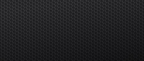 Black background with metal mesh with hexagonal cells