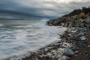 Rocky shore under cloudy sky photo