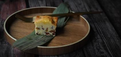 Slice of cake on wooden plate
