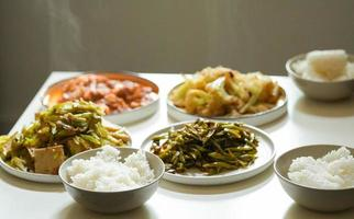 Asian cuisine dishes on table