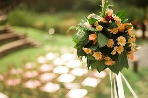 A bouquet of flowers at an outdoor wedding reception in a garden