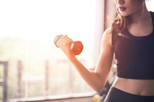 Woman lifts dumbbell  photo