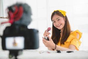 Beauty blogger creating makeup tutorial  photo