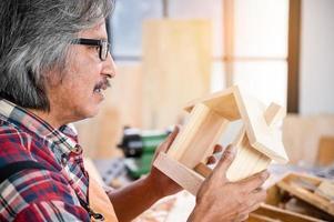 Man crafting a birdhouse