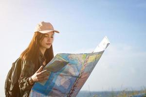 Woman hiker looking at map