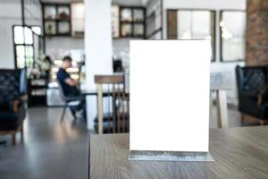 Blank poster on wood table in cafe