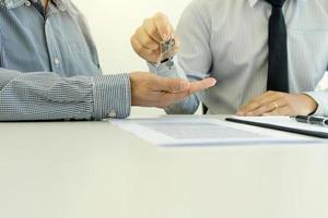 Businessman giving keys to client