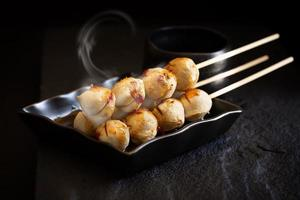 Roasted pork meatballs on dark background