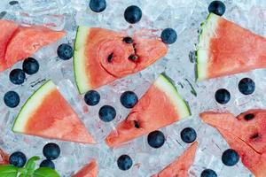 Sliced watermelon and blueberries on ice