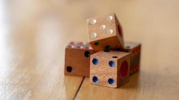 Dice made of wood on wooden table photo