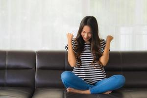 Portrait of happy woman on sofa