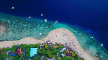 Aerial view of sandy Philippines beach with tourists
