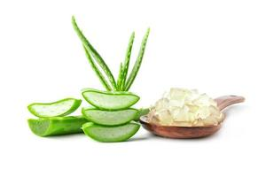 Fresh aloe vera with wooden spoon