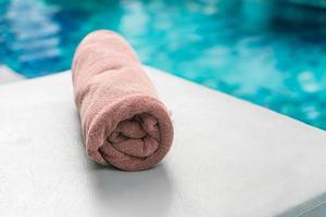 Pool towel next to swimming pool
