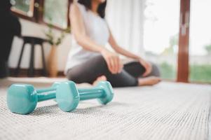 Pair of dumbbells on the living room floor