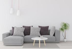 Sectional couch, coffee table, plant, and lamps photo