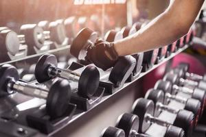 Hand with rows of dumbbells photo