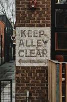 Keep alley clear sign on wall photo