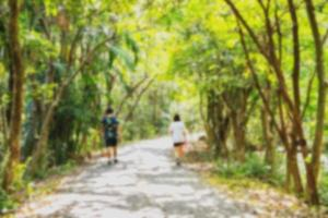 Blurred nature background of two people walking