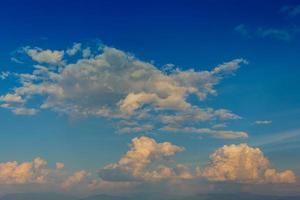 Blue sky and moving clouds photo
