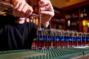 Alcoholic shots on bar counter