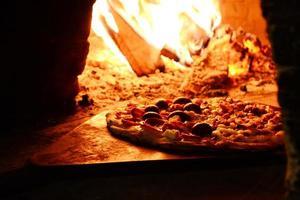 Pizza near bonfire photo
