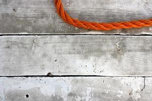 Orange rope on wooden floor