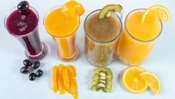 Glasses of juice and fruits