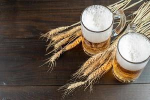 Glasses of beer with wheat stalks