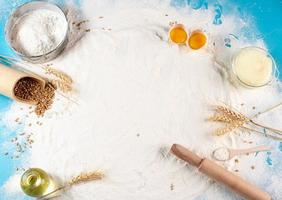 Baking ingredients on blue background