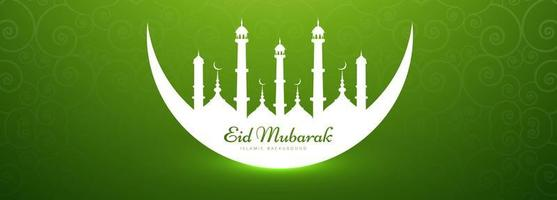 Eid Mubarak banner with mosque in crescent moon silhouette