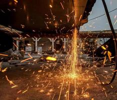 Welding sparks fly