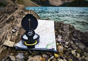 Compass and map on rocks