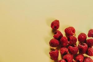 Yellow background with raspberries in corner