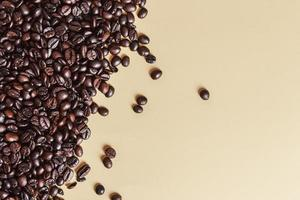 Roasted coffee beans on plain background