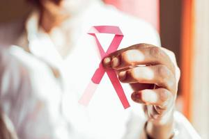 Woman holding pink ribbon