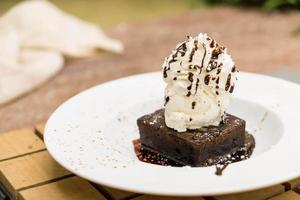 Brownie sundae with a scoop of vanilla ice cream photo