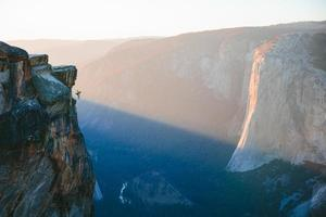 Man hanging from Taft Point