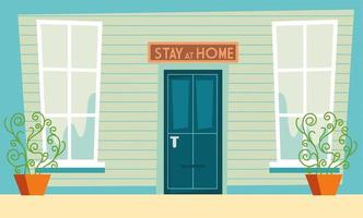 Stay at home awareness sign above door of home