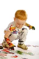 boy playing with paints photo