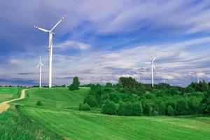 Wind turbine, renewable energy. Landscape with blue sky.