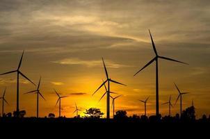 Wind turbine power generator with sunset photo
