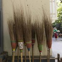 Straw brooms and novice at Maya Ganayon monastery, Amarapura, Myanmar
