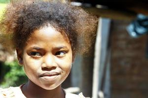 Cute young black African girl - poor child, madagascar photo